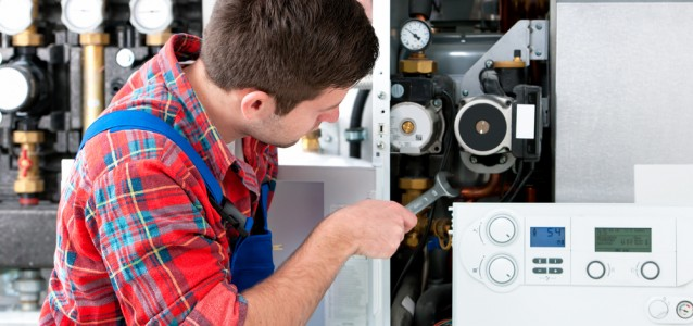 Picture of man servicing boiler